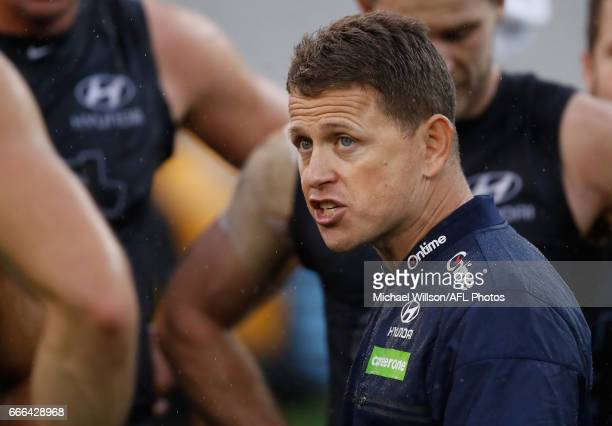 Brendon Bolton Senior Coach of the Blues addresses his players during the 2017 AFL round 03 match between the Carlton Blues and the Essendon Bombers...