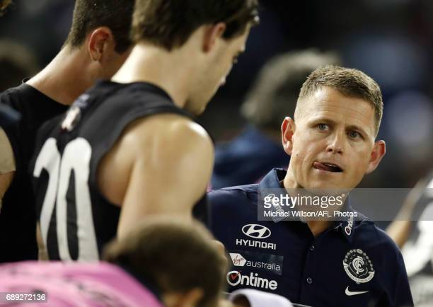 Brendon Bolton Senior Coach of the Blues addresses his players during the 2017 AFL round 10 match between the Carlton Blues and the North Melbourne...