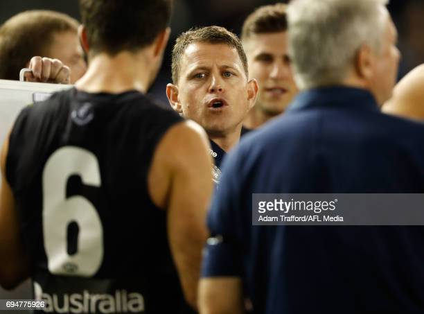Brendon Bolton Senior Coach of the Blues addresses his players during the 2017 AFL round 12 match between the Carlton Blues and the GWS Giants at...