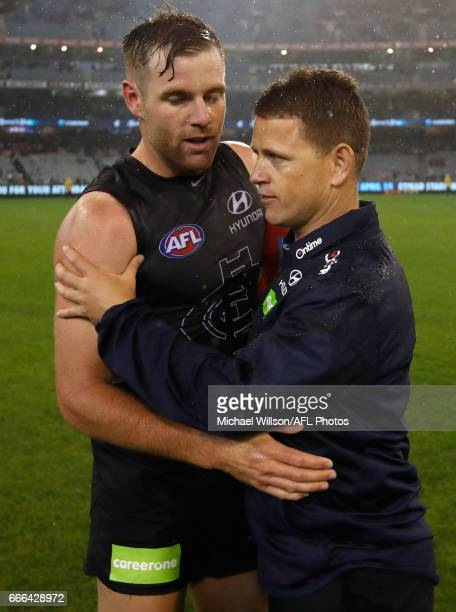 Brendon Bolton Senior Coach of the Blues and Sam Docherty of the Blues celebrate during the 2017 AFL round 03 match between the Carlton Blues and the...
