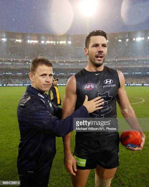 Brendon Bolton Senior Coach of the Blues and Simon White of the Blues celebrate during the 2017 AFL round 03 match between the Carlton Blues and the...