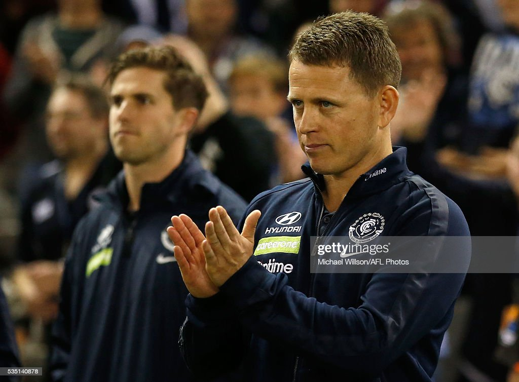 Brendon Bolton, Senior Coach of the Blues claps his players during the 2016 AFL Round 10 match between the Carlton Blues and the Geelong Cats at Etihad Stadium on May 29, 2016 in Melbourne, Australia.