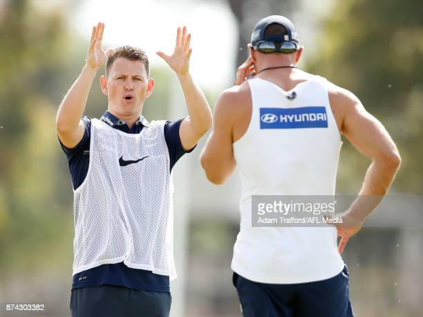 Brendon Bolton Senior Coach of the Blues speaks to his assistant coaches during the Carlton Blues training session at Princes Park on November 15...