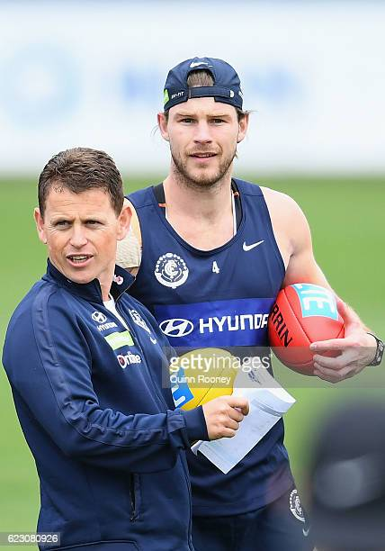 Brendon Bolton the coach of the Blues and Bryce Gibbs look on during the Carlton Blues AFL preseason training session at Ikon Park on November 14...