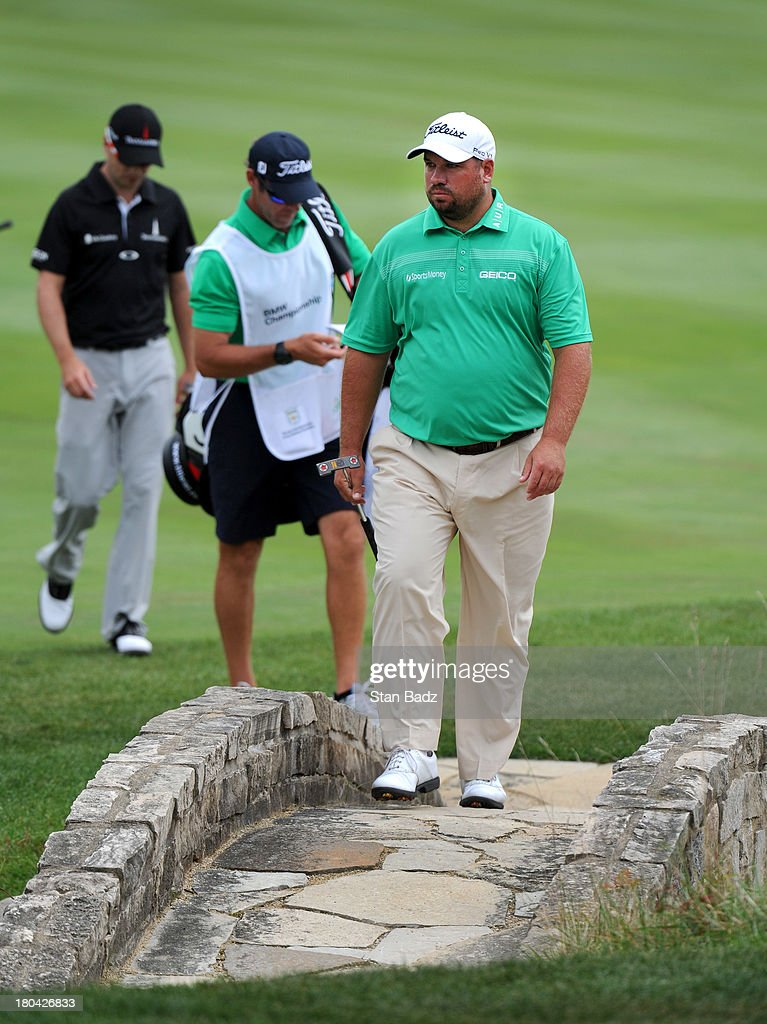 <a gi-track='captionPersonalityLinkClicked' href=/galleries/search?phrase=Brendon+de+Jonge&family=editorial&specificpeople=4444710 ng-click='$event.stopPropagation()'>Brendon de Jonge</a> of South Africa approaches the 18th green during the first round of the BMW Championship at Conway Farms Golf Club on September 12, 2013 in Lake Forest, Illinois.