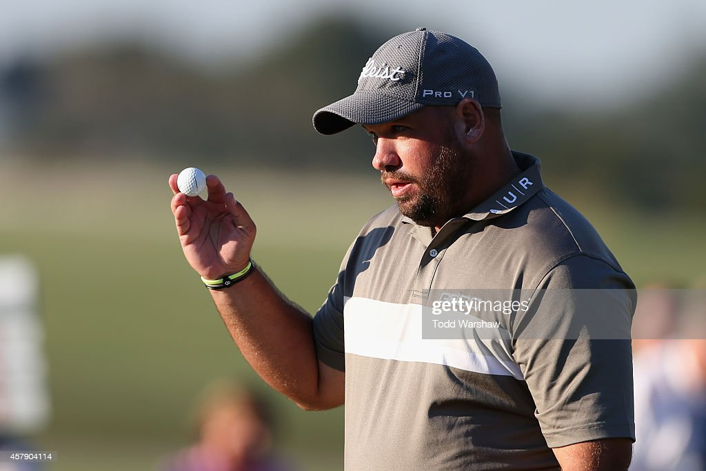 Brendon de Jonge of Zimbabwe acknowledges the crowd during a playoff in the final round of The McGladrey Classic at Sea Island's Seaside Course on...