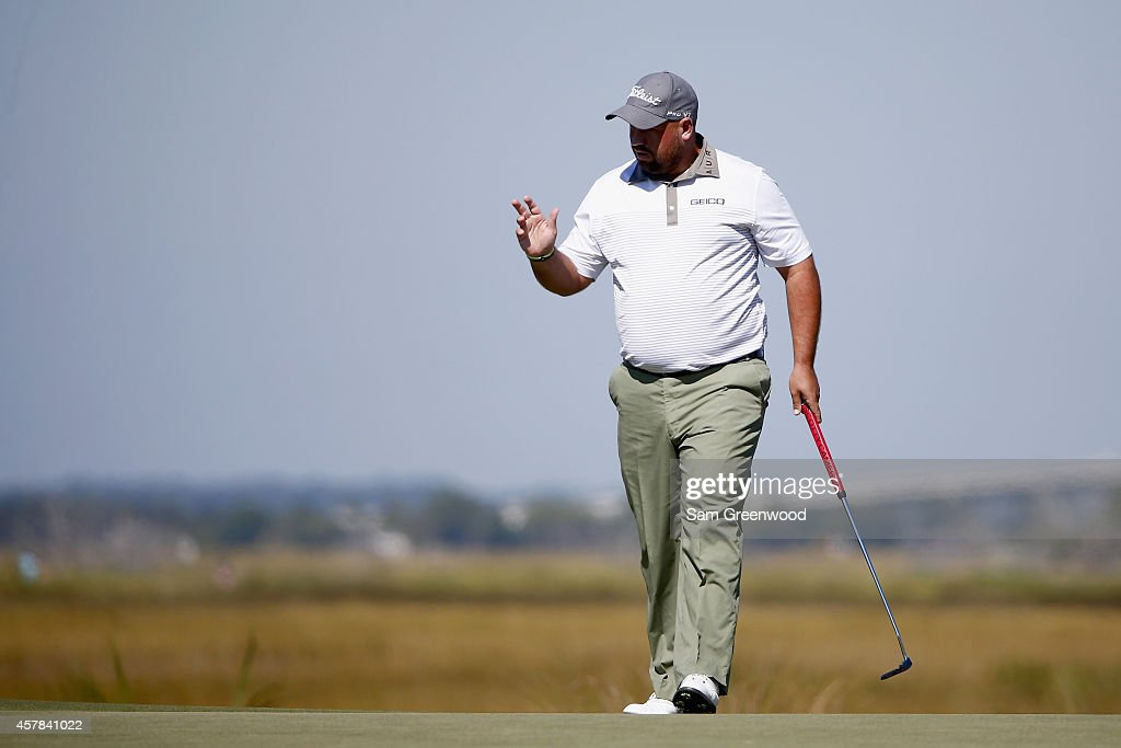 Brendon de Jonge of Zimbabwe acknowledges the crowd on the first green during the third round of The McGladrey Classic at Sea Island's Seaside Course...