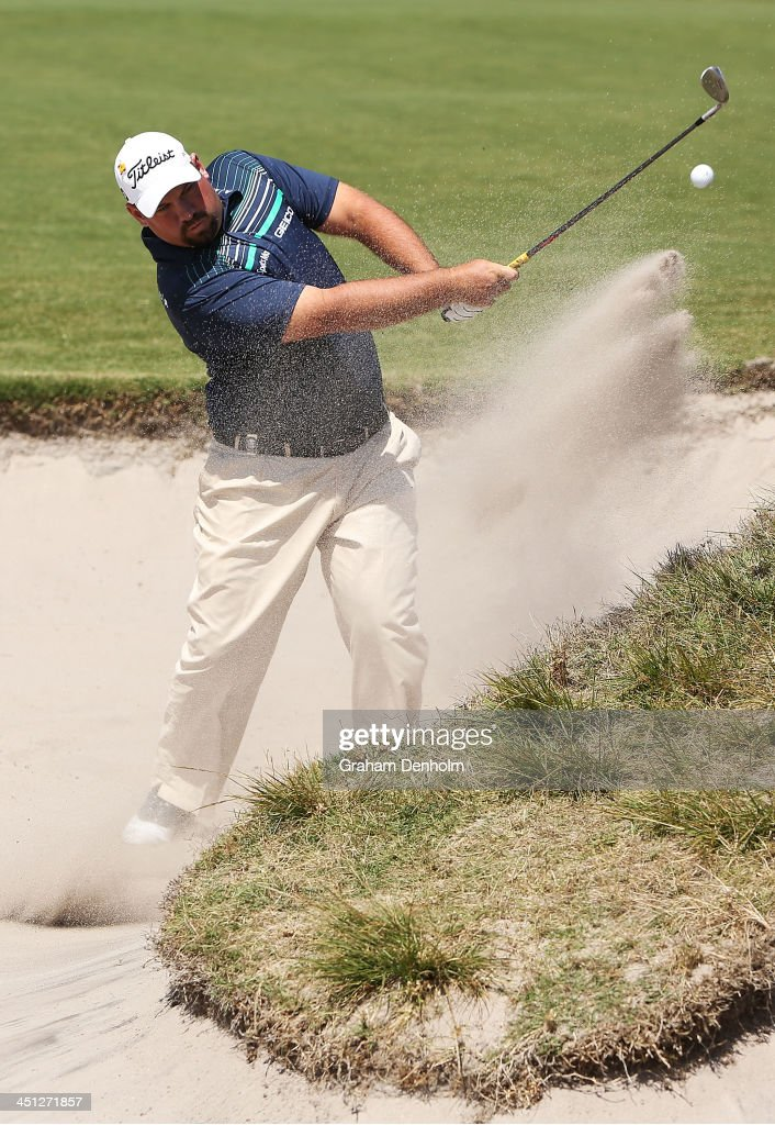 Brendon De Jonge of Zimbabwe hits a shot from the bunker during day two of the World Cup of Golf at Royal Melbourne Golf Course on November 22 2013...
