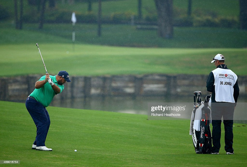 Brendon De Jonge of Zimbabwe in acton during the compleation of the weather delayed second round of the 2014 Turkish Airlines Open at The Montgomerie...