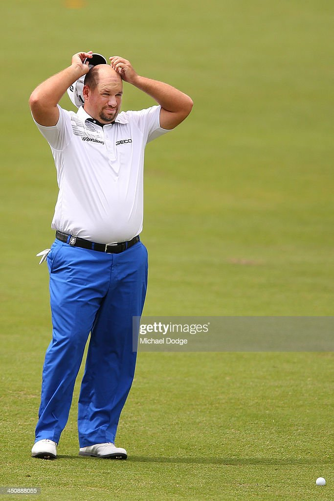Brendon De Jonge of Zimbabwe looks ahead before an approach shot during day one of the World Cup of Golf at Royal Melbourne Golf Course on November 21, 2013 in Melbourne, Australia.