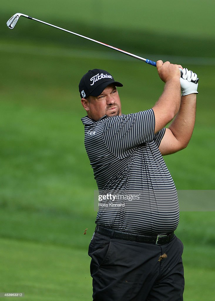 Brendon de Jonge of Zimbabwe plays his second shot on the 14th hole during the second round of The Barclays at The Ridgewood Country Club on August...
