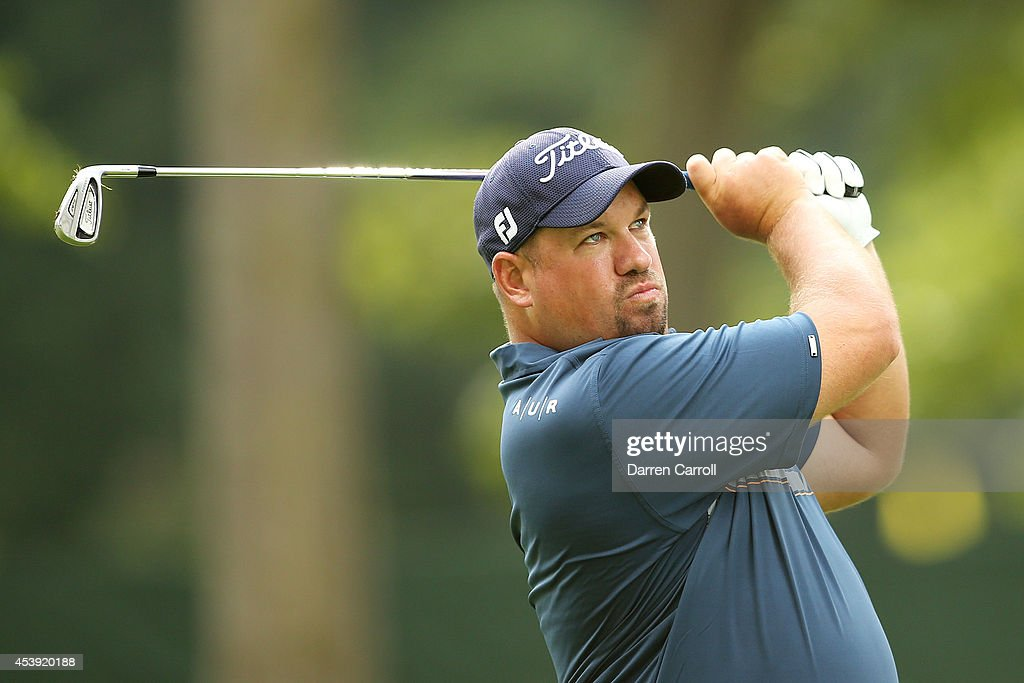 Brendon de Jonge of Zimbabwe plays his second shot on the 18th hole during the first round of The Barclays at The Ridgewood Country Club on August 21...