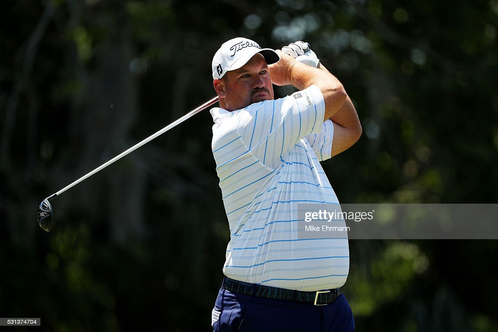 Brendon de Jonge of Zimbabwe plays his shot from the seventh tee during the third round of THE PLAYERS Championship at the Stadium course at TPC...