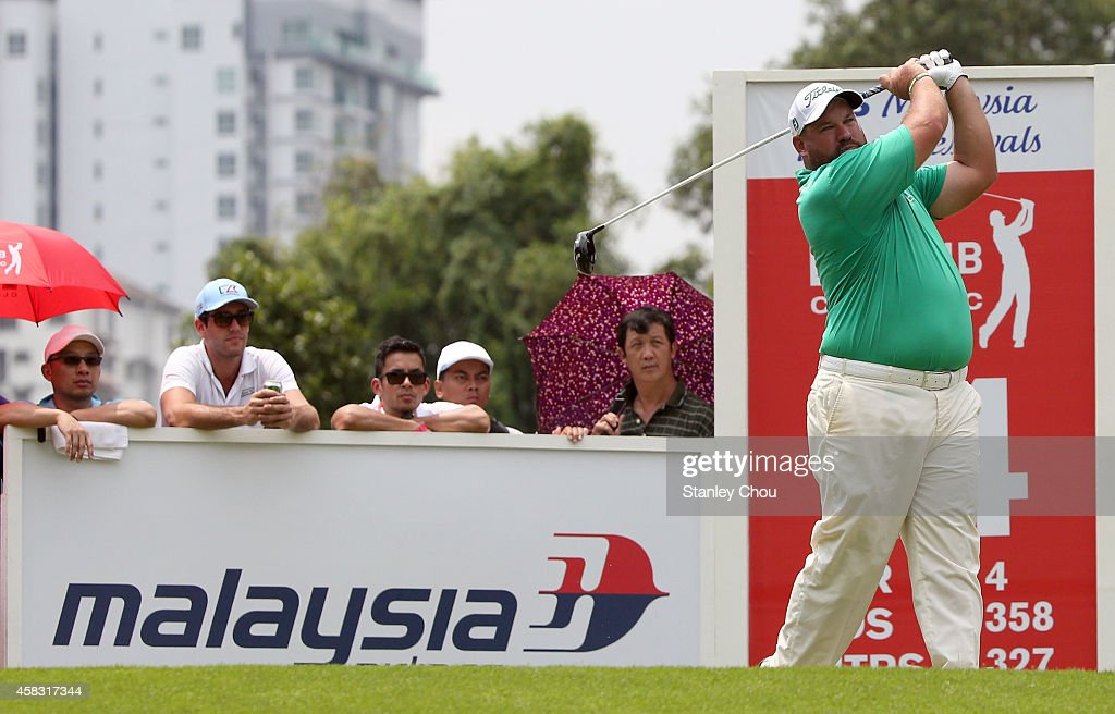 Brendon De Jonge of Zimbabwe plays on on the 14th hole during day four of the 2014 CIMB Classic at Kuala Lumpur Golf Country Club on November 2 2014...