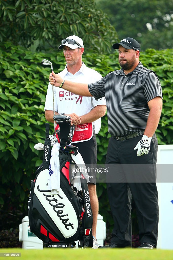 Brendon De Jonge of Zimbabwe prepares to play during day two of the 2014 CIMB Classic at Kuala Lumpur Golf Country Club on October 31 2014 in Kuala...