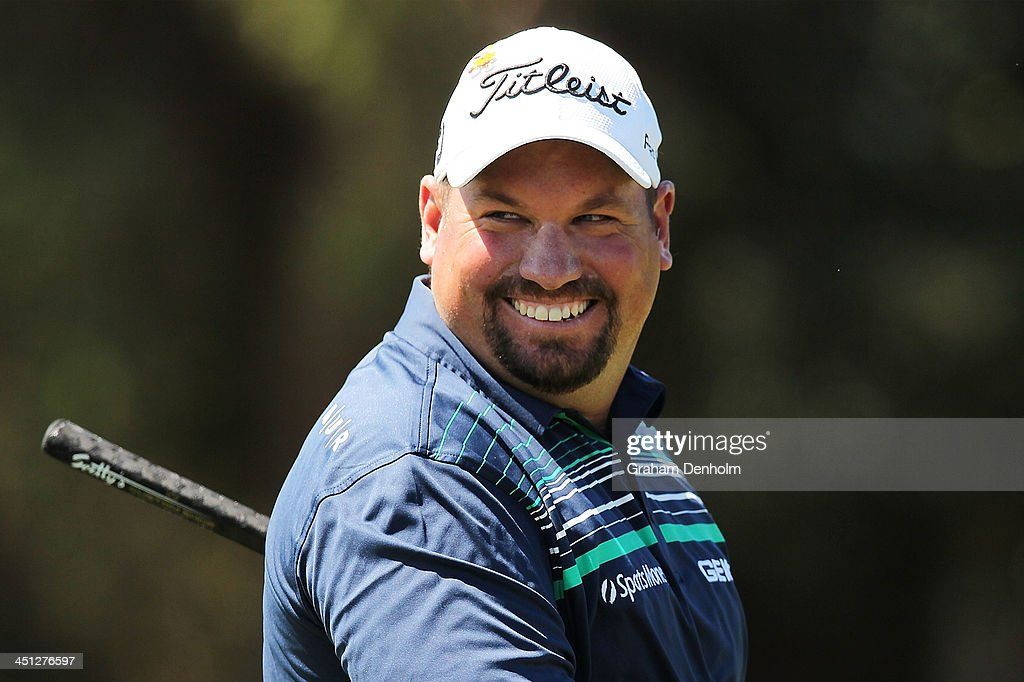 Brendon De Jonge of Zimbabwe smiles during day two of the World Cup of Golf at Royal Melbourne Golf Course on November 22 2013 in Melbourne Australia