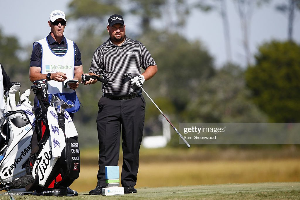 Brendon de Jonge of Zimbabwe talks with his caddie on the 8th hole during the second round of The McGladrey Classic at Sea Island's Seaside Course on...