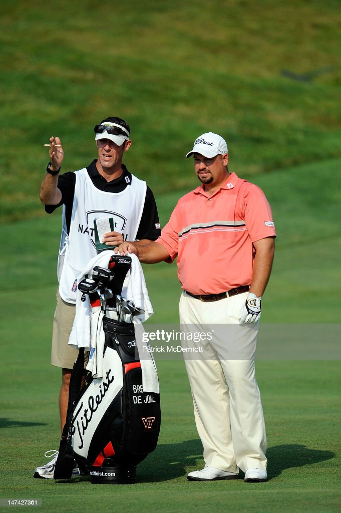 Brendon de Jonge of Zimbabwe talks with his caddy on the fifth fairway during Round Two of the ATT National at Congressional Country Club on June 29...