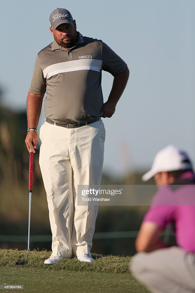 Brendon de Jonge of Zimbabwe watches as Robert Streb lines up a putt on the final playoff hole in the final round of The McGladrey Classic at Sea...