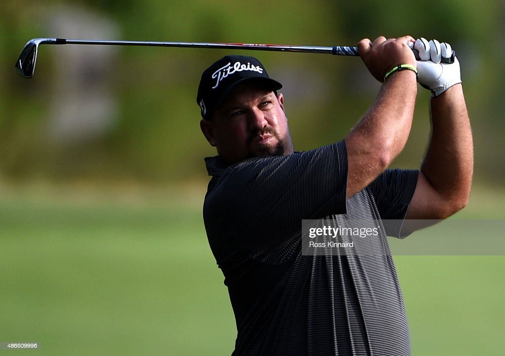Brendon de Jonge of Zimbabwe watches his second shot on the seventh hole during round one of the Deutsche Bank Championship at TPC Boston on...