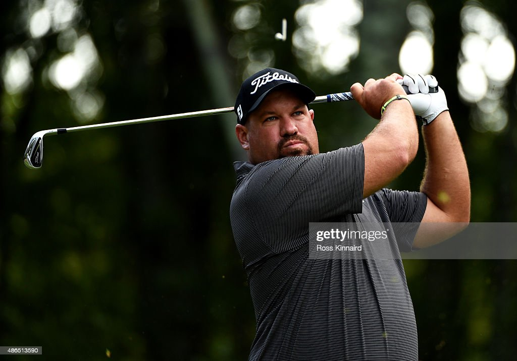 Brendon de Jonge of Zimbabwe watches his tee shot on the eighth hole during round one of the Deutsche Bank Championship at TPC Boston on September 4...