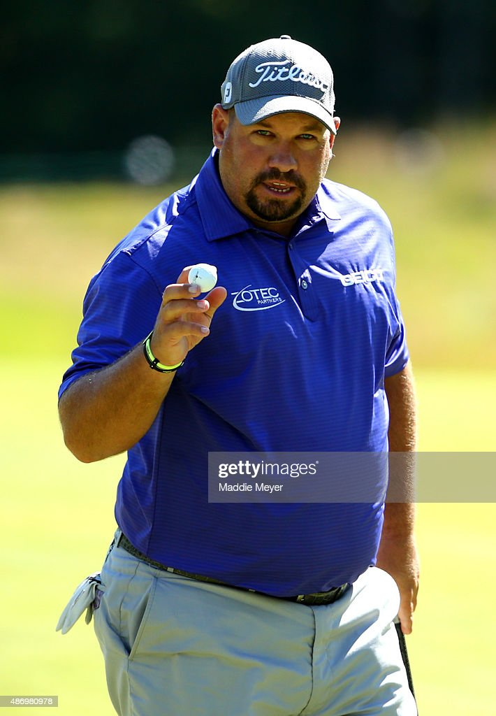 Brendon de Jonge of Zimbabwe waves to fans on the ninth green during round two of the Deutsche Bank Championship at TPC Boston on September 5 2015 in...