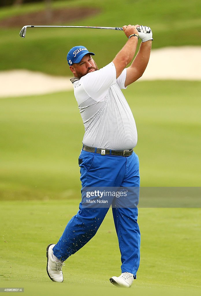 Brendon De Jonge of Zimbawe plays an approach shot on the 18th hole during day one of the 2014 Australian Open at The Australian Golf Course on...