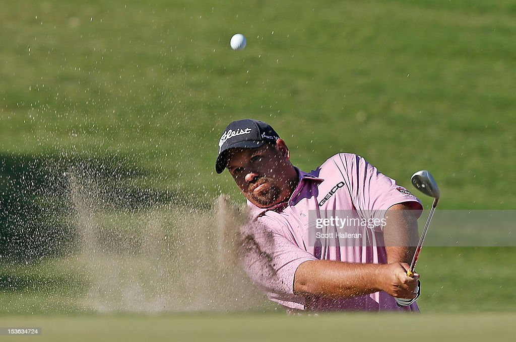 <a gi-track='captionPersonalityLinkClicked' href=/galleries/search?phrase=Brendon+de+Jonge&family=editorial&specificpeople=4444710 ng-click='$event.stopPropagation()'>Brendon de Jonge</a> plays a bunker shot on the 15th hole during the final round of the Justin Timberlake Shriners Hospitals for Children Open at TPC Summerlin on October 7, 2012 in Las Vegas, Nevada.