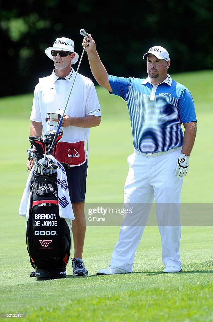 Brendon de Jonge takes a club out of his bag on the fifth hole during the third round of the Quicken Loans National at Congressional Country Club on...