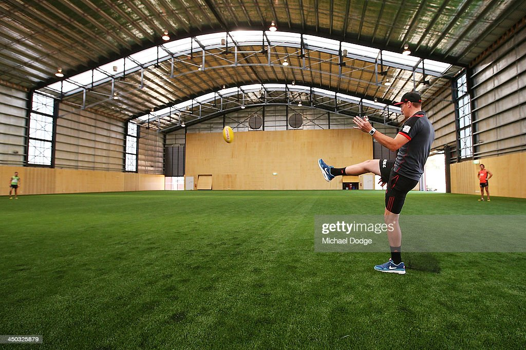 Brendon Goddard kicks the ball in the hangar at the new Essendon Bombers AFL training facility at Tullamarine on November 18, 2013 in Melbourne, Australia.