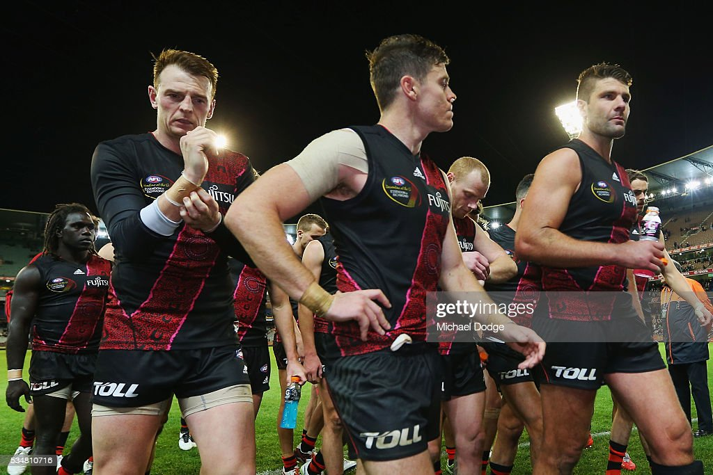 <a gi-track='captionPersonalityLinkClicked' href=/galleries/search?phrase=Brendon+Goddard&family=editorial&specificpeople=217747 ng-click='$event.stopPropagation()'>Brendon Goddard</a> of the Bombers (L) and teammates walk of after defeat during the round 10 AFL match between the Essendon Bombers and the Richmond Tigers at Melbourne Cricket Ground on May 28, 2016 in Melbourne, Australia.