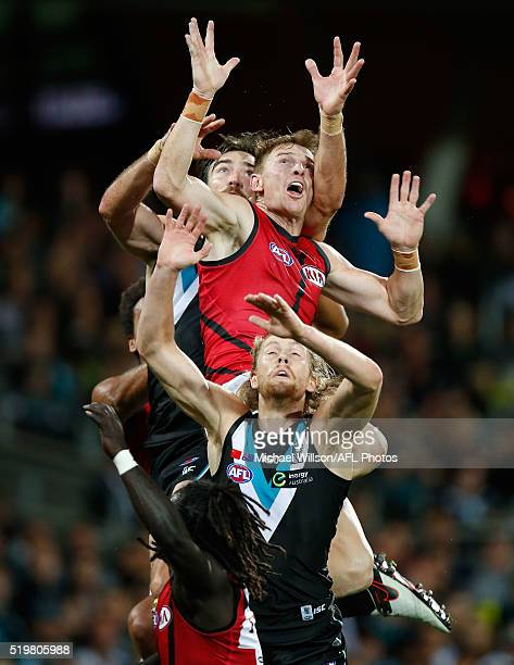 Brendon Goddard of the Bombers attempts to mark over Charlie Dixon and Aaron Young of the Power during the 2016 AFL Round 03 match between Port...