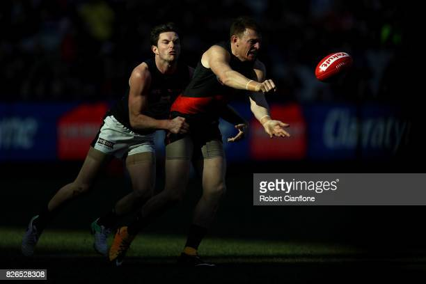 Brendon Goddard of the Bombers handballs during the round 20 AFL match between the Essendon Bombers and the Carlton Blues at Melbourne Cricket Ground...