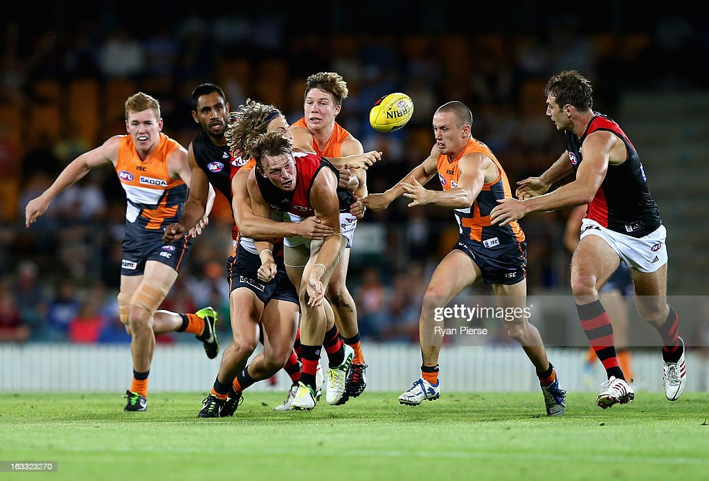 <a gi-track='captionPersonalityLinkClicked' href=/galleries/search?phrase=Brendon+Goddard&family=editorial&specificpeople=217747 ng-click='$event.stopPropagation()'>Brendon Goddard</a> of the Bombers handballs during the round three NAB Cup AFL match between the Greater Western Sydney Giants and the Essendon Bombers at Manuka Oval on March 8, 2013 in Canberra, Australia.
