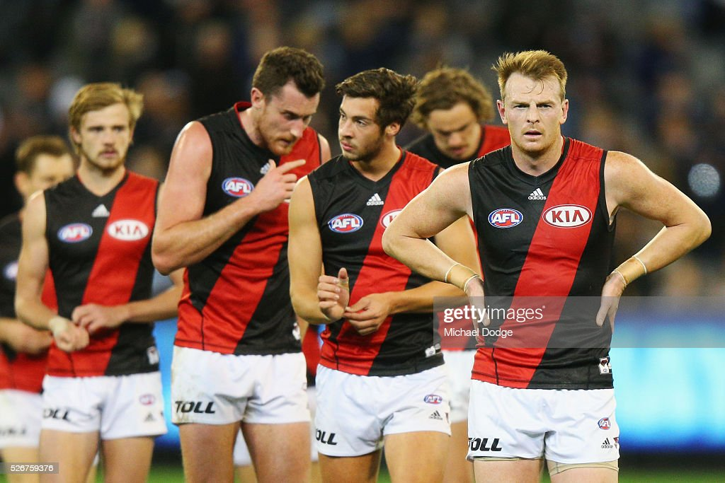 Brendon Goddard of the Bombers leads the team off after defeat during the round six AFL match between the Carlton Blues and the Essendon Bombers at Melbourne Cricket Ground on May 1, 2016 in Melbourne, Australia.