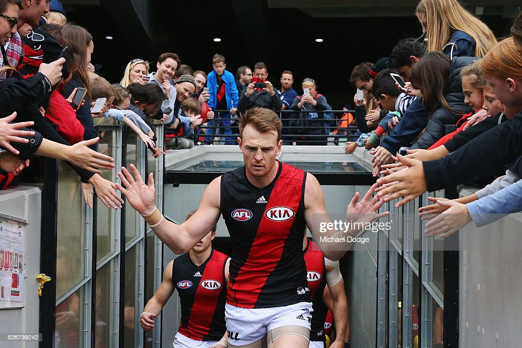 Brendon Goddard of the Bombers leads the team out during the round six AFL match between the Carlton Blues and the Essendon Bombers at Melbourne Cricket Ground on May 1, 2016 in Melbourne, Australia.