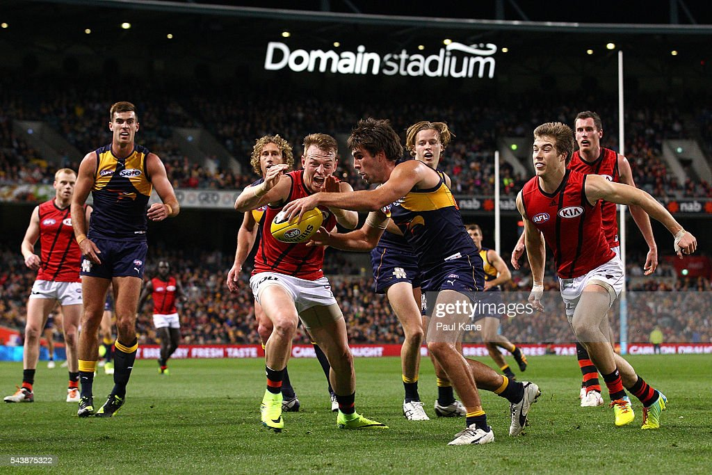 Brendon Goddard of the Bombers looks to smother the kick by Andrew Gaff of the Eagles during the round 15 AFL match between the West Coast Eagles and the Essendon Bombers at Domain Stadium on June 30, 2016 in Perth, Australia.
