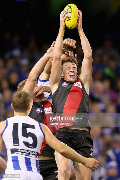 Brendon Goddard of the Bombers marks infront of Jarrad Waite of the Kangaroos during the round 16 AFL match between the North Melbourne Kangaroos and...