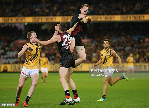 Brendon Goddard of the Bombers marks the ball against Jack Riewoldt of the Tigers during the round 10 AFL match between the Essendon Bombers and the...