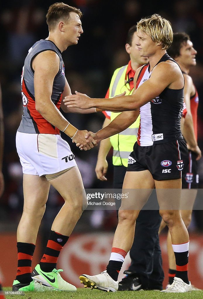 Brendon Goddard (L) of the Bombers shakes hands with Clinton Jones of the Saints after the game in the round four AFL match between the St Kilda Saints and the Essendon Bombers at Etihad Stadium on April 20, 2013 in Melbourne, Australia.
