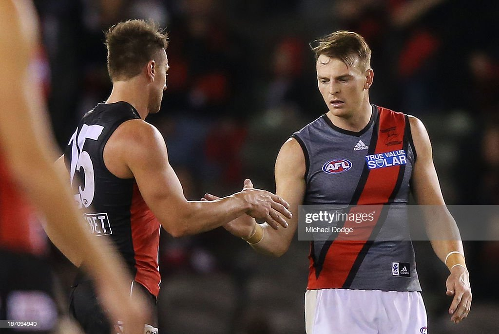 Brendon Goddard (R) of the Bombers shakes hands with Sam Fisher of the Saints after the game in the round four AFL match between the St Kilda Saints and the Essendon Bombers at Etihad Stadium on April 20, 2013 in Melbourne, Australia.