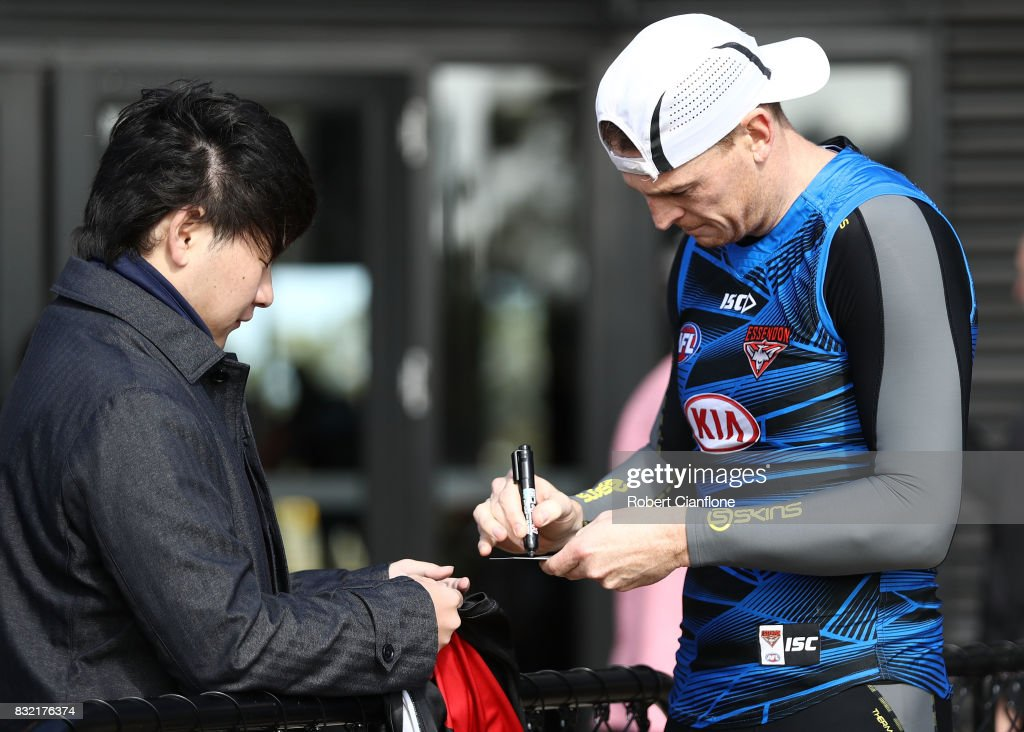 Brendon Goddard of the Bombers signs an autograph for a fan during an Essendon Bombers AFL training session at the Essendon Football Club on August 16, 2017 in Melbourne, Australia.