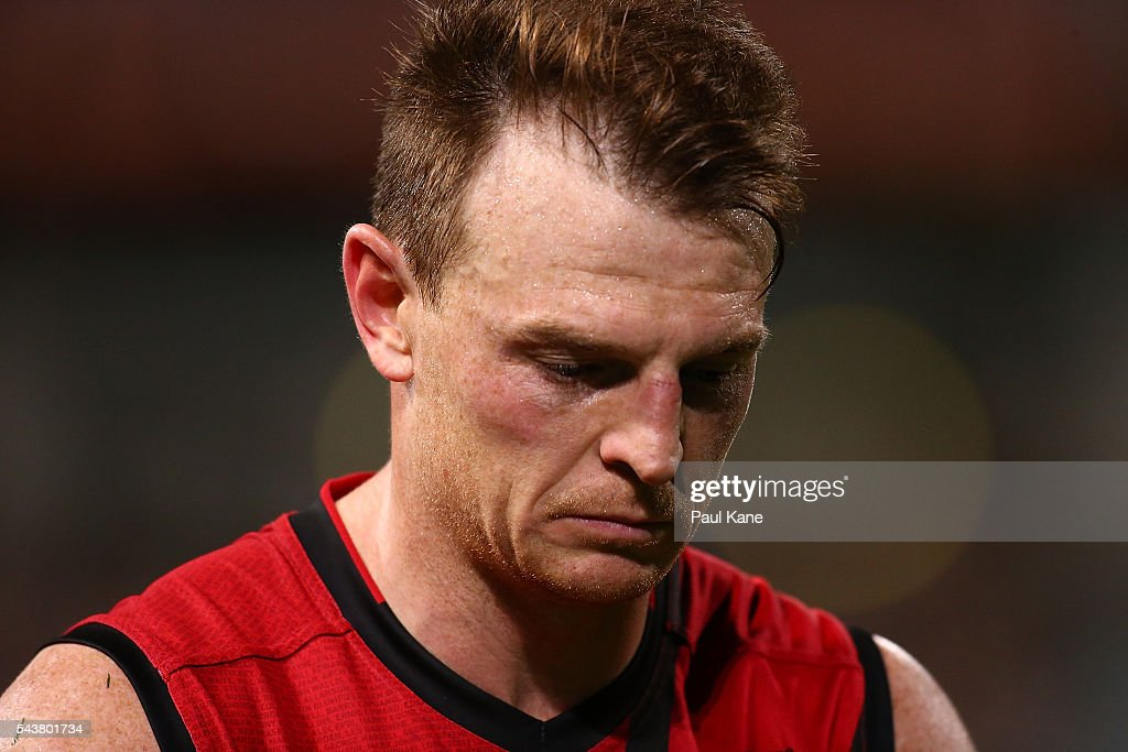 <a gi-track='captionPersonalityLinkClicked' href=/galleries/search?phrase=Brendon+Goddard&family=editorial&specificpeople=217747 ng-click='$event.stopPropagation()'>Brendon Goddard</a> of the Bombers walks from the field after being defeated during the round 15 AFL match between the West Coast Eagles and the Essendon Bombers at Domain Stadium on June 30, 2016 in Perth, Australia.