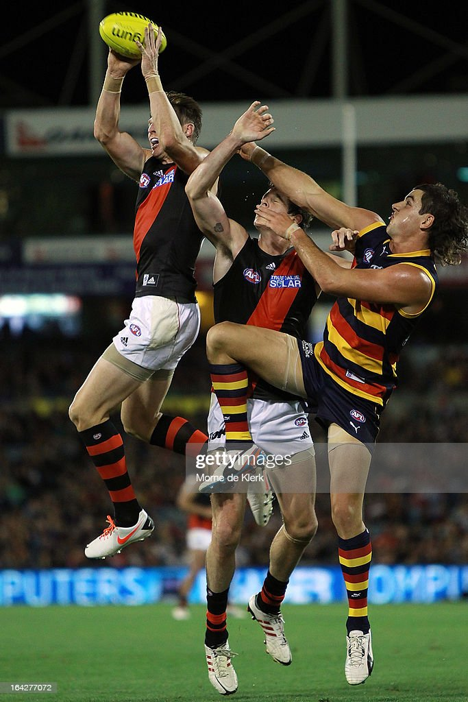 <a gi-track='captionPersonalityLinkClicked' href=/galleries/search?phrase=Brendon+Goddard&family=editorial&specificpeople=217747 ng-click='$event.stopPropagation()'>Brendon Goddard</a> (L) takes a mark over Taylor Walker of the Crows during the round one AFL match between the Adelaide Crows and the Essendon Bombers at AAMI Stadium on March 22, 2013 in Adelaide, Australia.