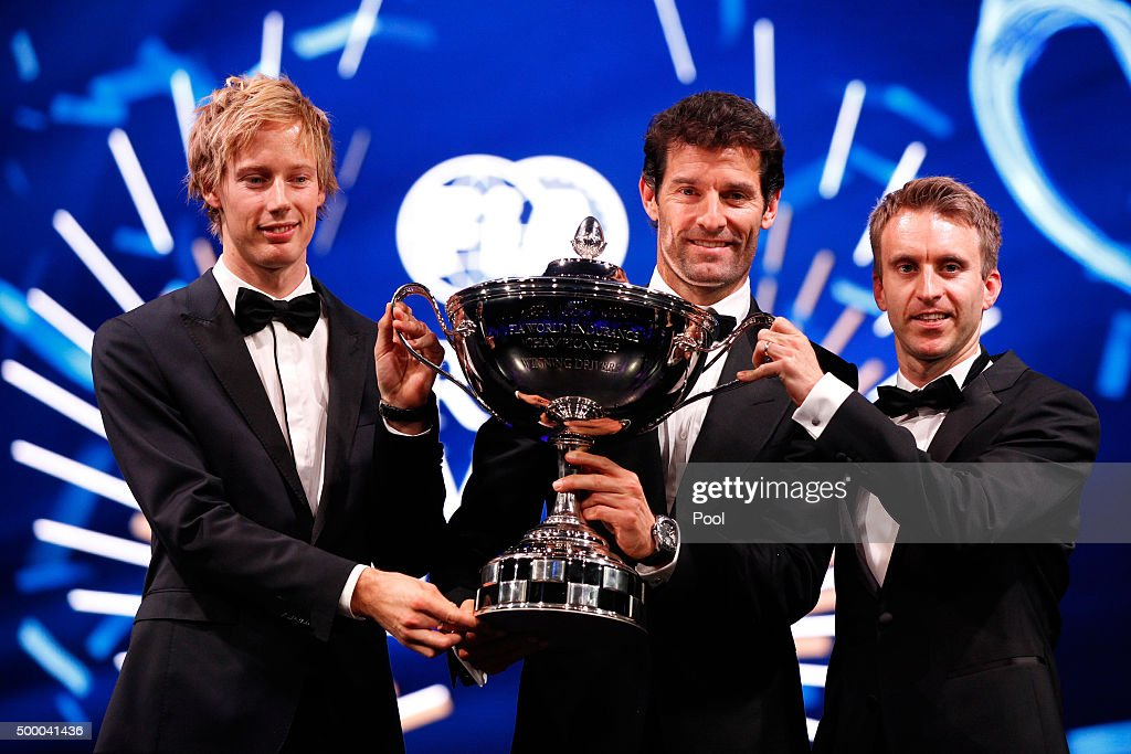 <a gi-track='captionPersonalityLinkClicked' href=/galleries/search?phrase=Brendon+Hartley&family=editorial&specificpeople=4823179 ng-click='$event.stopPropagation()'>Brendon Hartley</a> of New Zealand and Porsche, <a gi-track='captionPersonalityLinkClicked' href=/galleries/search?phrase=Mark+Webber+-+Race+Car+Driver&family=editorial&specificpeople=167271 ng-click='$event.stopPropagation()'>Mark Webber</a> of Australia and Porsche and <a gi-track='captionPersonalityLinkClicked' href=/galleries/search?phrase=Timo+Bernhard&family=editorial&specificpeople=4194103 ng-click='$event.stopPropagation()'>Timo Bernhard</a> of Germany and Porsche pose with the 2015 FIA World Endurance Championship trophy during the 2015 FIA Prize-Giving Ceremony at the Lido Theatre on December 4, 2015 in Paris, France.