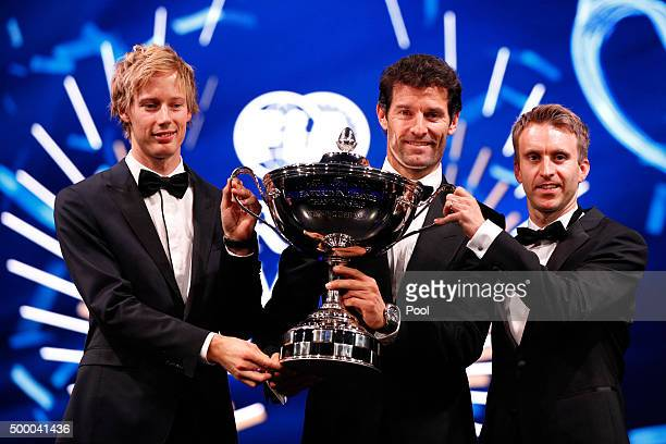 Brendon Hartley of New Zealand and Porsche Mark Webber of Australia and Porsche and Timo Bernhard of Germany and Porsche pose with the 2015 FIA World...