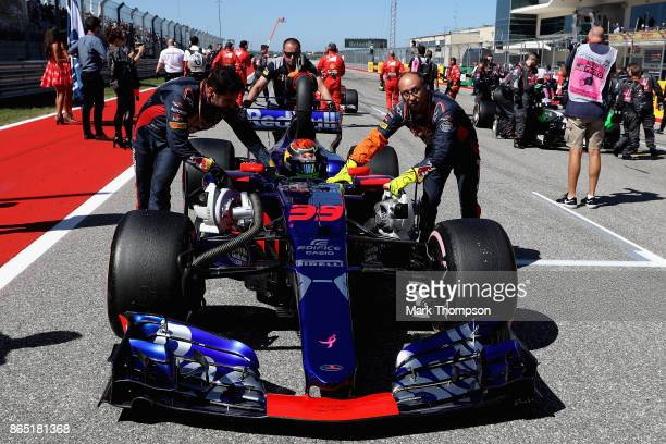 Brendon Hartley of New Zealand and Scuderia Toro Rosso is pushed onto the grid before the United States Formula One Grand Prix at Circuit of The...