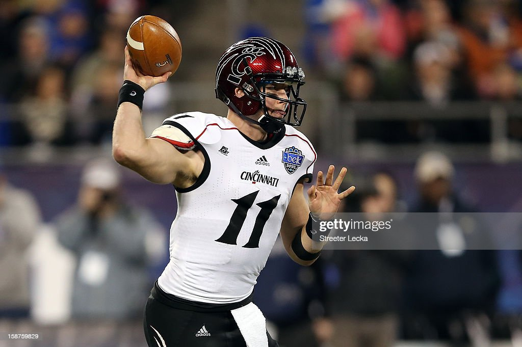 Brendon Kay #11 of the Cincinnati Bearcats drops back to pass against the Duke Blue Devils during their game at Bank of America Stadium on December 27, 2012 in Charlotte, North Carolina.