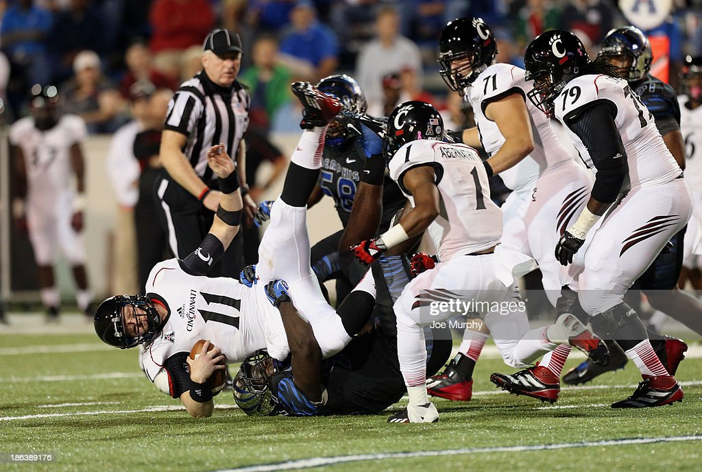 Brendon Kay #11 of the Cincinnati Bearcats is sacked Martin Ifedi #97 of the Memphis Tigers on October 30, 2013 at Liberty Bowl Memorial Stadium in Memphis, Tennessee.