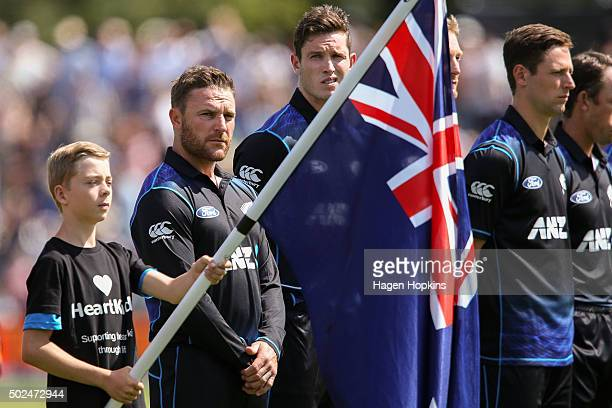 Brendon McCullum and Adam Milne of New Zealand of New Zealand line up for the national anthem during the first One Day International match between...